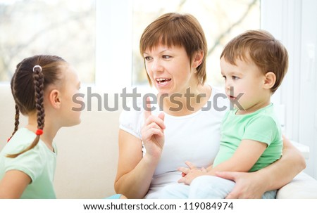 Mother talking to her children, indoor shoot - stock photo