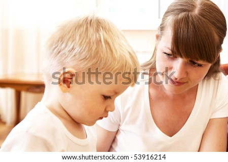 mother talking with her unhappy son at home