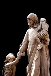 Mother Teresa statue with poor children,  Saint Mother Teresa of Calcutta