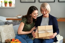 Mother unpacking a gift with her adult daughter
