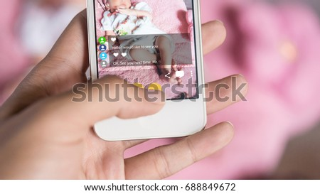 Mother using smartphone record video of her baby live chat to her Friend. Streaming Video is a most popular in social networks