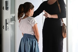 Mother warning her daughter (age 10) how to behave before she live home.