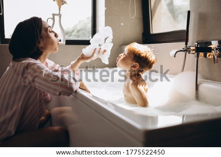Mother washing little son in bathroom Photo stock ©
