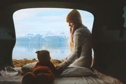 Mother with baby in car family travel vacation road trip woman with child enjoying mountains view from camper van healthy lifestyle trip in Norway