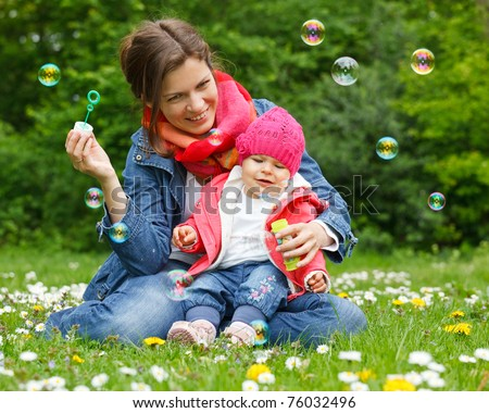 Mother with baby in the park