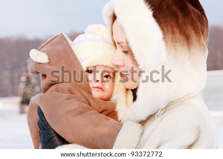 Mother with baby in winter
