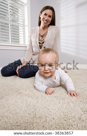 Mother with baby learning to crawl