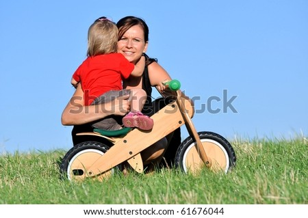 Mother with baby on blue sky background