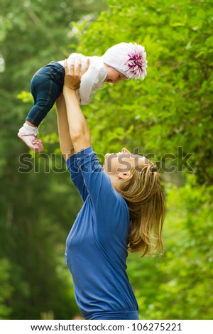 Mother with baby outdoors