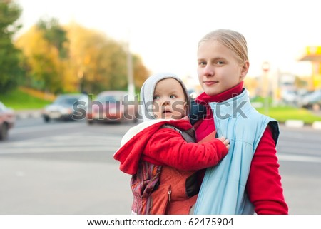 mother with baby stay on crossroad