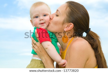 Mother with  baby  under blue sky