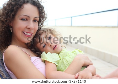 mother with child on veranda