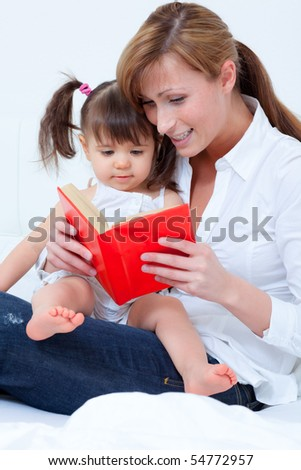 Mother with child playing and reading book