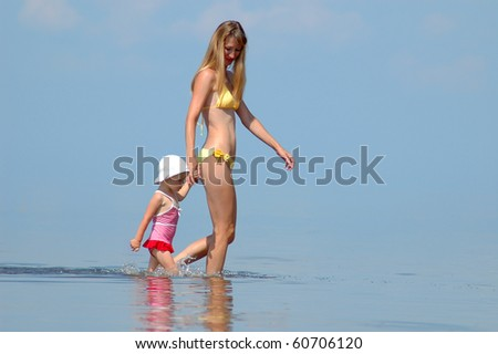 Mother with child walk on the water