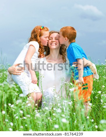 mother with children goes on field