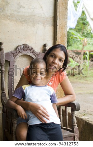 mother with children house Nicaragua Corn Island