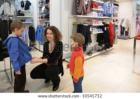 mother with children in clothing shop