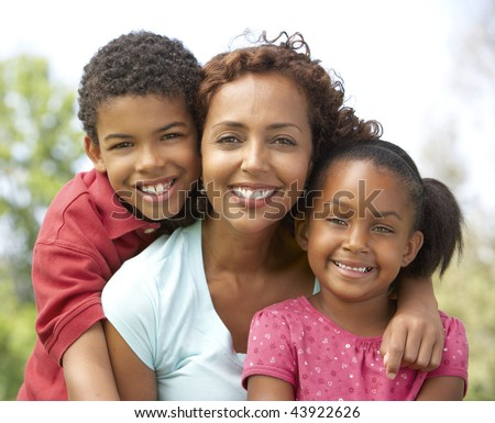 Mother With Children In Park
