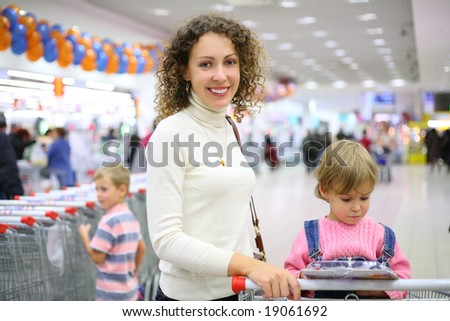 mother with children in shop