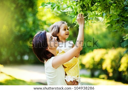 Mother with daughter in garden