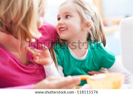 Mother with daughter, smiling