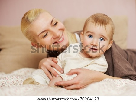 Mother with her adorable baby at home