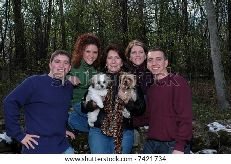 mother with her adult children and dogs