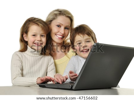 Mother with her children using laptop