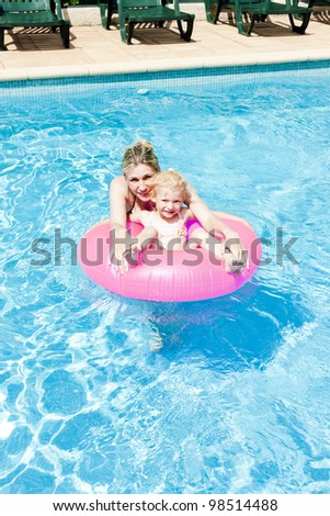 mother with her daughter in swimming pool