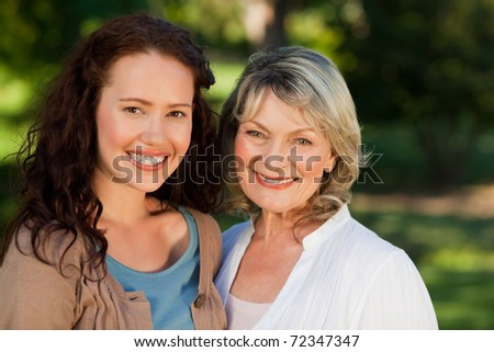 Mother with her daughter looking at the camera in the park