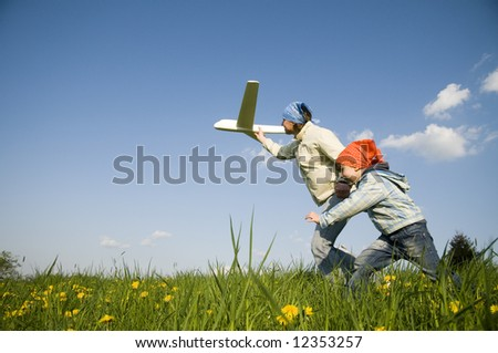 Mother with her daughter with plane model