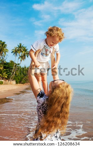 Mother with her little son on the beach