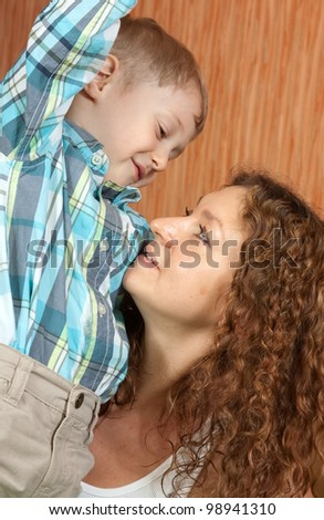mother with her son in home interior