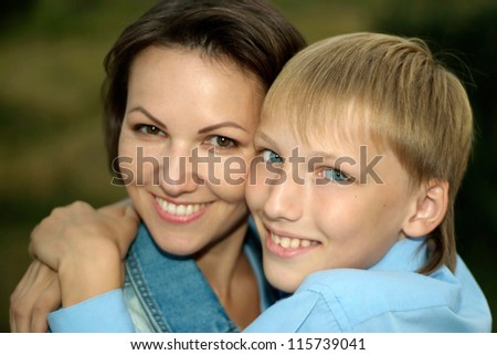 mother with her son on a walk in the summer