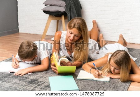 Mother with her two children at indoors and studying