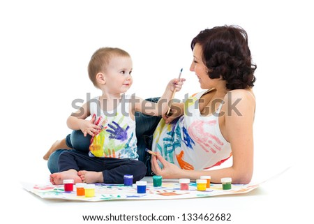 mother with kid boy drawing and painting together