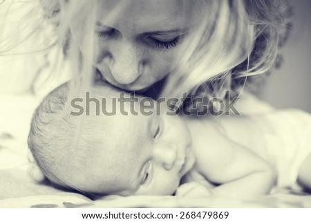 mother with newborn baby child...