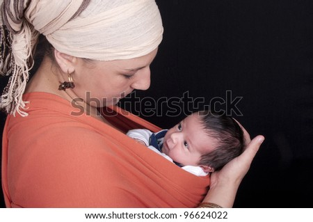 mother with newborn on black background