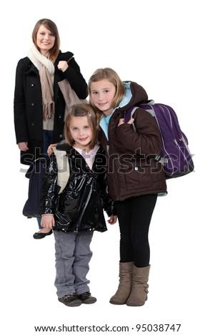 Mother with schoolgirls