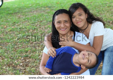 Mother with son and daughter in the park
