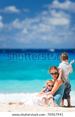 Mother with son and daughter on beach vacation
