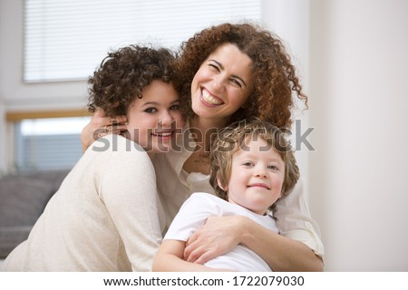 Mother with son and daughter, portrait