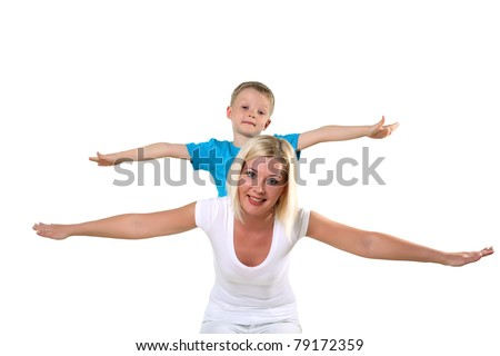 mother with son playing and having fun in studio