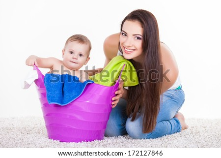 Mother with Son Sitting In Laundry Basket on white. Family, adorable kid, love and happiness concept.