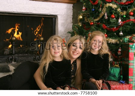 mother with twin daughters at christmas