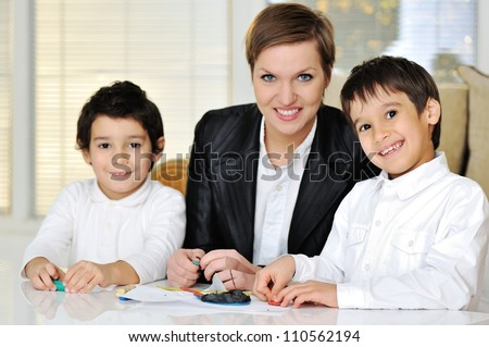 Mother working with sons on homework project