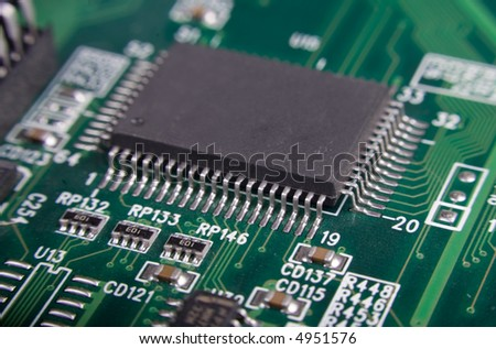 motherboard's green electronic circuit - macro with shallow depth of field