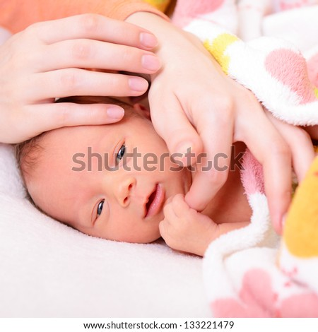 mothercare, cute newborn baby with young mother's hands