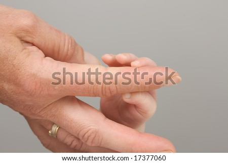 motherhand and little baby fingers