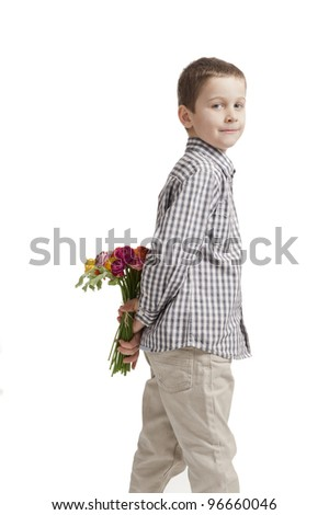 mothers day: boy hiding a bouquet of flowers behind his back. On white background